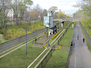 A 4.4-mile streetcar line under study would run in the Midtown Greenway next to a popular bike trail in Minneapolis. The rendering shows what a station at Bloomington Avenue could look like, if the streetcar ran on turf-embedded tracks. (Submitted rendering: Metro Transit)