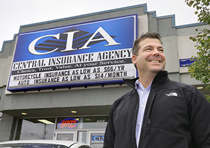 Compared with the last time Dave Peterson tried to borrow money to buy another business, this last go-round was a breeze, said Peterson at the office of his latest acquisition, Cambridge Insurance Agency in Cambridge. (Staff photo: Bill Klotz)