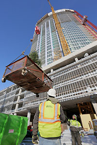 Crews raised a Christmas tree to the top of the nearly finished 36-story LPM Apartments complex during a topping out ceremony Tuesday at 1369 Spruce Place in the Loring Park area of Minneapolis. (Staff photo: Bill Klotz)