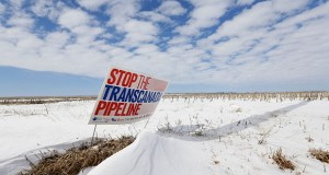 "In this March 2013 photo, a sign reading ""Stop the Transcanada Pipeline"" stands in a field near Bradshaw, Neb., along the Keystone XL pipeline route through the state. (AP file photo)"