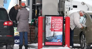 Customers fill up Monday at an SuperAmerica gas station on East Lake Street at 44th Ave S. in Minneapolis Motorists may soon be paying more for gas if a new transportation funding proposal becomes law. (Staff photo: Bill Klotz)