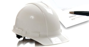 White construction workers hard hat on white