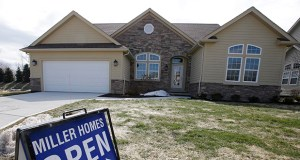 This March 21, 2014 photo shows a new home for sale in Pepper Pike, Ohio. (AP Photo: Tony Dejak)