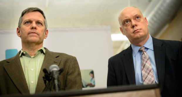 """MNsure Chairman Brian Beutner, left, and interim CEO Scott Leitz listen during a press conference on Dec. 18, 2013, in Minneapolis. """"The open enrollment was the first act in a several-act play,"""" Beutner said last week. (AP file photo: Star Tribune, Glen Stubbe)"""