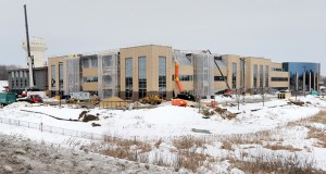Upsher-Smith's Maple Grove headquarters is undergoing a 134,481-square-foot addition scheduled for completion in 2014. The three-level structure will include offices, labs and a warehouse. (Staff photo: Bill Klotz)
