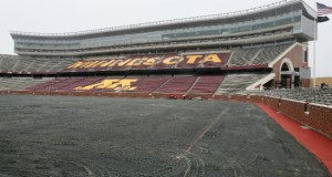 Crews began installing new heated turf at the University of Minnesota's TCF Bank Stadium this week. The Minnesota Vikings will use the stadium in 2014 and 2015 while their new stadium is under construction. (Staff Photo: Bill Klotz)