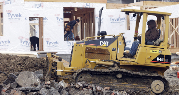 Construction equipment maker Caterpillar reported Thursday that its first-quarter earnings rose 5 percent, and it raised its forecast for profit for the year. Its sales to construction, energy and transportation companies improved. (AP file photo)