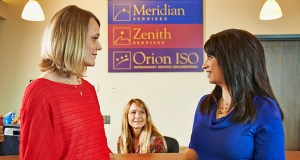 Erin Huldeen, program administrator, Ceil Van Campen, program administrator, and Lara Trujillo, ISO coordinator, converse at Orion Associates in Golden Valley. (Submitted photo)