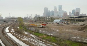 """The 25-acre Linden Yards area shown from Van White Memorial Boulevard Bridge. Ryan Cos. has proposed a mix of commercial and residential buildings for a portion of the area, but is still talking with potential partners. """"They're all waiting on the same thing we are, which is a decision on Southwest LRT,"""" said Rick Collins, a Ryan vice president. (Staff photo: Bill Klotz)"""