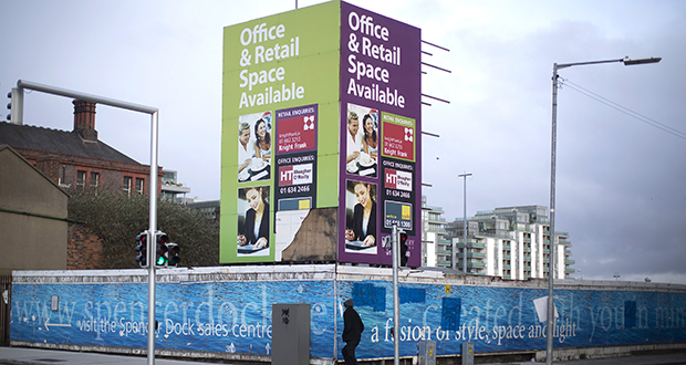 A billboard advertises office and retail space at North Wall Quay in Dublin, Ireland. About 14 percent of Dublin office space remains vacant. While office rents have risen by a third since 2011, they're still about 45 percent below peak levels in 2006. (Bloomberg News file photo)