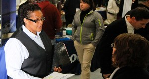 In this May 16 photo, Megan Lory, left, talks with Sandra Modena, sales manager at Trillium Staffing, at a veterans job fair in downtown Muskegon, Mich. (AP photo: The Muskegon Chronicle)