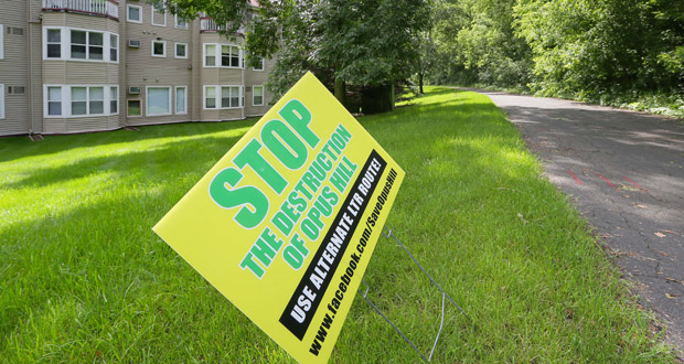 A lawn sign supporting a reroute proposal backed by owners of the Claremont Apartments, which would be within 30 yards or so of the Southwest Light Rail transit line. Efforts to rally support for a proposed reroute haven't swayed city planning staff. (Staff photo: Bill Klotz)