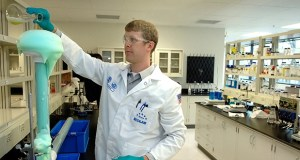 Nate Ortmann, an Ecolab chemist, analyzes a chemistry solution at Ecolab's Research, Development and Engineering facility in Eagan. Ecolab is one of about 900 entities in the state's water technology industry. (Submitted photo: Ecolab)