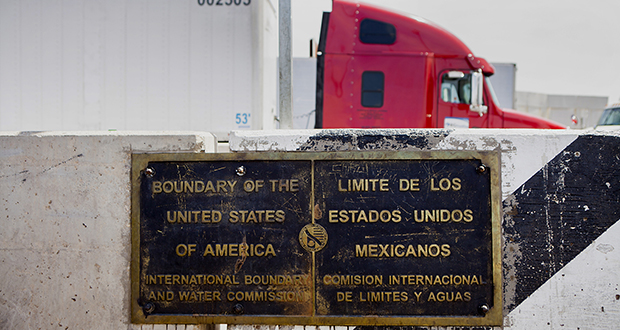 Minnesota's exports to Mexico surged 49 percent to $433 million over the past year. Machinery sales were one reason. In this photo, a plaque showing the boundary between the U.S. and Mexico is visible as a truck driver waits April 9 in Calexico, California. (Bloomberg News file photo)