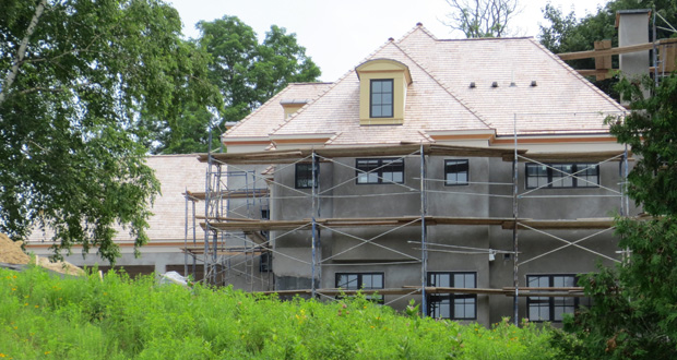 Six years after breaking ground on the first homes in Locust Hills, builders finally are at work on the last of 47 lots in the exclusive Wayzata enclave. The developers' patience in courting the market's wealthiest buyers has paid off, with one early home selling in May for $6.05 million. (Submitted photo)