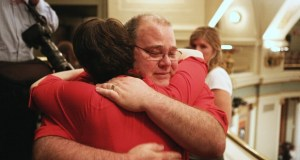 Medical marijuana advocates embrace after the Minnesota House voted May 9 to legalize use of cannabis products by patients with qualifying conditions. (Staff photo: James Nord)