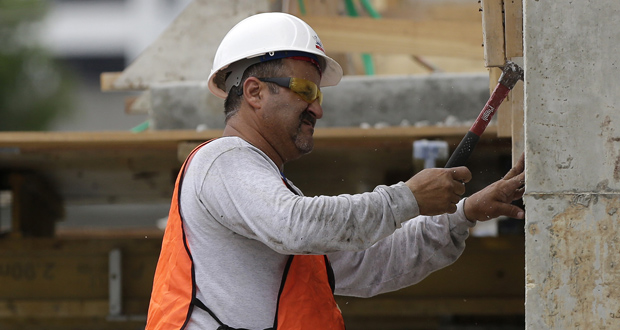 A builder works May 16 on the site of the SoMa at Brickell apartment building in downtown Miami. (AP file photo)