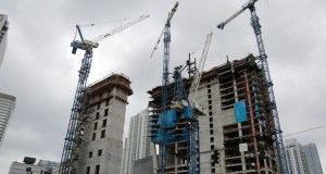 Cranes fill the skyline May 16 at the Brickell CityCentre construction site in the center of the financial district in downtown Miami. (AP photo)