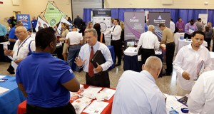 In this photo taken July 16, job seekers check out the opportunities at a Hiring Fair For Veterans in Fort Lauderdale, Fla. (AP photo)