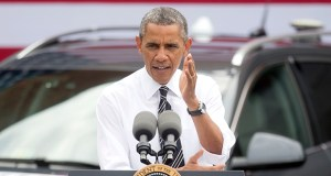 """President Barack Obama, shown Tuesday at a transportation research center in Virginia, says he supports the House and Senate bills to keep transportation aid flowing to states, but wants more. """"All this does is set us up for the same crisis a few months from now,"""" he said. (AP photo: Pablo Martinez Monsivais)"""