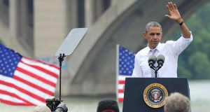 With the Key Bridge, which links Washington and northern Virginia, in the background, President Barack Obama finishes a speech about the economy and transportation Tuesday at Georgetown Waterfront Park in Washington. (AP photo: Susan Walsh)