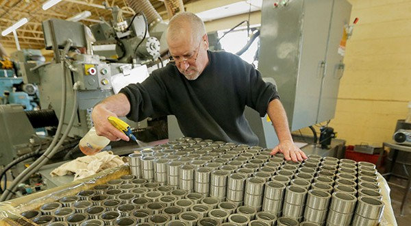 Machinst Joel Linvenfelser works on brushings at Cass Screw Machine Products in Brooklyn Center on Jan. 17. A Friday Creighton University report credited durable goods manufacturers for much of Minnesota's growth. (File photo: Bill Klotz)