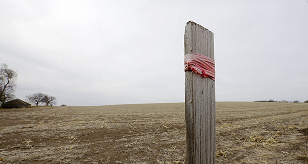 This March 17 photo shows a stake that marks the route of the Keystone XL pipeline in Tilden, Neb. (AP file photo)