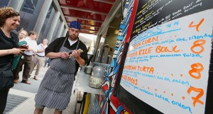 Officials say local sales and use tax revenue is growing as the economy improves and people become more willing to spend their money, as they were Thursday at Kyle Olson's food truck, Get Sauced, in downtown Minneapolis. (Staff photo: Bill Klotz)