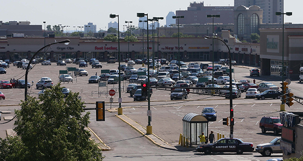 To accommodate development on the 34.5-acre site at the busy Snelling and University avenues intersection in St. Paul, a consultant team recommends a new road opposite Spruce Tree Drive through the Midway Shopping Center and south of a future Walgreens store. (Staff photo: Bill Klotz)