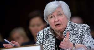 """Janet Yellen, chair of the U.S. Federal Reserve, speaks during a Senate Banking Committee hearing July 15 in Washington. Yellen told lawmakers the central bank must press on with monetary stimulus as """"significant slack"""" remains in labor markets and inflation is still below the Fed's goal. (Bloomberg News photo: Andrew Harrer)"""