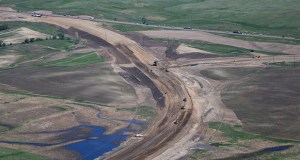 In this June 12 aerial photo, heavy machinery plows through farmland for the construction of the U.S. Route 85 bypass around Watford City in North Dakota's booming oil region. Congress has kept federal highway and transit programs limping along for the past six years, unable to decide how best to pay for them. (AP file photo)