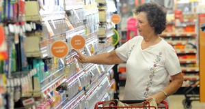 Frances Gurley shops Sept. 4 at a Family Dollar store in Wilmington, N.C. The Commerce Department reported Monday that consumer spending in August rose 0.5 percent from the previous month. (AP photo)