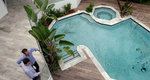 Developer Michael Capponi, left, talks on Sept. 24 with real estate broker Massimo Nicastro, right, of South Beach Estates, at a waterfront property he renovated, during a viewing for brokers, in Miami Beach, Fla. The S&P/Case-Shiller index of property values had in July its smallest 12-month since November 2012 as investors step back from the real estate market. (AP Photo: Lynne Sladky)