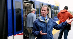 """Mark Fuhrmann, Metro Transit's director of rail projects, says the fact that two Twin Cities light rail projects are in the pipeline for federal funding shows the Federal Transit Administration """"has confidence in what we do and how we do it."""" Fuhrmann is shown in a photo taken earlier this year near a train on the Green Line.  (File photo: Bill Klotz)"""