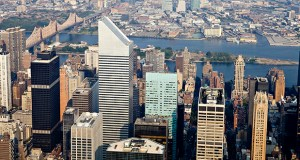 Office buildings, including 601 Lexington Ave., center left, stand in midtown Manhattan on July 7, 2010 in this aerial photograph taken over New York. Norway has spent more than $3.2 billion on U.S. real estate this year, including a 45 percent stake in 601 Lexington Ave., as its sovereign wealth fund seeks to meet a target to invest as much as 5 percent of its assets in real estate. (Bloomberg file photo)