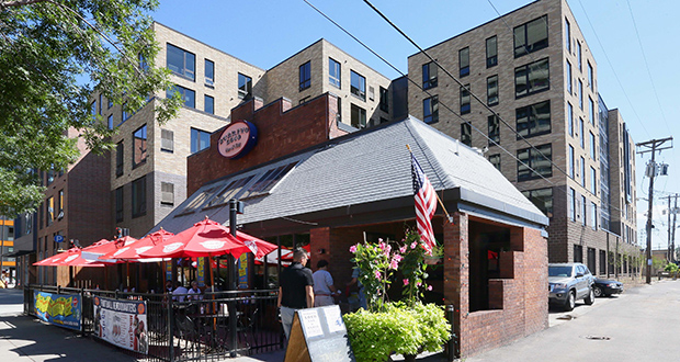 Burrito Loco, which used to be surrounded by parking lots at 13th Avenue Southeast and Fifth Street Southeast, now is hemmed in by The Opus Group's Venue apartment building. (Staff photo: Bill Klotz)