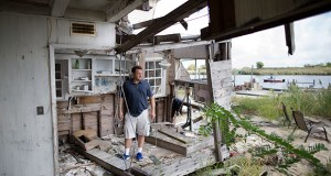 Gary Silberman guides reporters Sept. 5 on a tour of his parent's home that was destroyed by Superstorm Sandy, in Lindenhurst, New York. After Silberman received nearly $17,000 in assistance from FEMA, the agency is demanding a return on the funds. (AP Photo: John Minchillo)