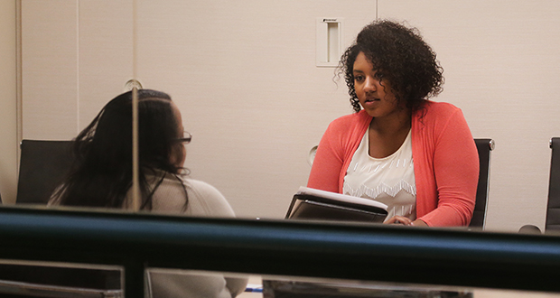 GradStaff Account Specialist II Amber Campbell (right) interviews an Upper Iowa University graduate who is looking for a job in human services. Tightening labor markets could encourage businesses to rely more on third-party recruiters like GradStaff. (Staff photo: Bill Klotz)