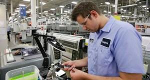 Jonah Devorak tests the dimensions on a high-pressure valve Sept. 9, 2014 at Swagelok Co. in Strongsville, Ohio. (AP file Photo)
