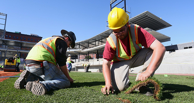 Jason Bruggeman, left, and Corey Sundet install Wisconsin-grown sod along the third base line of the new $63 million St. Paul Saints ballpark at Fifth and Broadway streets in St. Paul's Lowertown area. CHS Field is scheduled for completion in spring 2015. (Staff Photo: Bill Klotz)