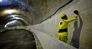 A worker checks a section of a wall during the final stage of construction on the Tunnel Rio 450 project in Rio de Janeiro, Brazil, on Thursday. The tunnel is part of the Porto Maravilha development project to refurbish the area surrounding Rio's port ahead of the 2016 Olympic Games. (Bloomberg News photo)