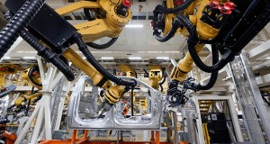 Robots install rivets on a 2015 Ford F-150 truck Nov. 11 at the Dearborn Truck Plant in Dearborn, Michigan. The Commerce Department reported Friday that business inventories increased 0.3 percent in September. (AP Photo: Paul Sancya)