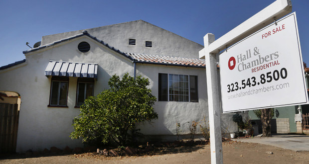 A realty sign hangs in front of a home for sale Oct. 27 in Los Angeles. The National Association of Realtors reported Thursday that sales of existing homes rose 1.5 percent in October. (AP Photo: Nick Ut)