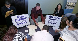 Job seekers fill out job applications Oct. 22 at a job fair in Miami Lakes, Fla. The Labor Department reported Thursday that more than 5 million people were hired in September, the most since December 2007. (AP Photo: Alan Diaz)