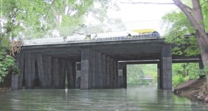 A thin deck light rail bridge is one of the concepts suggested to carry Southwest trains over the Kenilworth Channel between Cedar Lake and Lake of the Isles in Minneapolis. (Submitted rendering: Metropolitan Council)