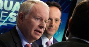 "Allergan CEO David Pyott, left, and Actavis CEO Brenton Saunders, are interviewed Nov. 17 on the floor of the New York Stock Exchange. Pyott is set to rake in an estimated $100 million in ""golden parachute"" payments, according to a study done by pay-tracking firm Equilar at the request of The Associated Press. (AP file Photo: Richard Drew)"