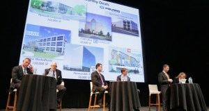 Representatives from CBRE, Cushman & Wakefield/NorthMarq, Colliers International and NorthMarq Capital spoke before a crowded room Tuesday at the Walker Art Center in Minneapolis. The office market, according to the panel, gives locals reasons to be optimistic. (Staff photo: Bill Klotz)