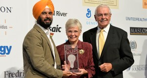 Deepinder Singh, left, the founder and CEO of Mankato-based 75F, receives the Minnesota Cup in September from Dave and Carolyn Cleveland. Dave Cleveland served on the Minnesota Cup's Grand Prize Review Board. (Submitted photo)