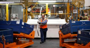 Agil Alhaddi stacks roof rails for the 2015 Ford F-150 on Nov. 11 at the Dearborn Truck Plant in Dearborn, Mich. The Commerce Department reported Friday that factory orders fell 0.7 percent in October. (AP Photo: Paul Sancya)