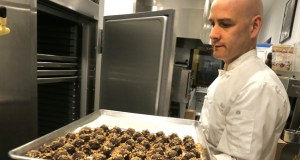 Mark Dixon, co-owner of Legacy Chocolates, prepares a batch of caramel pecan truffles at his store on the skyway level of the Pioneer Endicott apartment building in downtown St. Paul. (Staff photo: Bill Klotz)